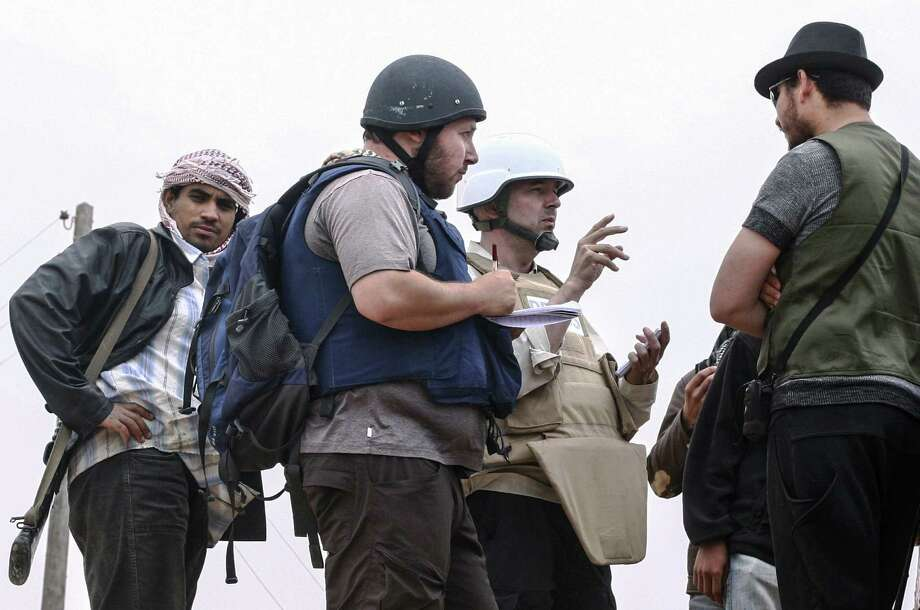 Letters slain journalist Steven Sotloff (center, black helmet) wrote to his family members were read at his memorial service. In the notes, he told them to be happy and stay positive and that he hoped they'd meet in heaven. Photo: Getty Images / File Photo / 2014 Etienne de Malglaive