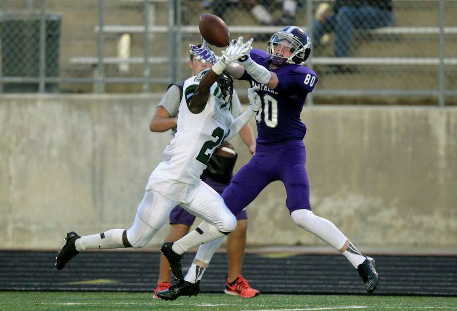 Hightower defensive back Robert Grays (21) is called for pass interference on Ridge Point Trey Brock (80) during the first half of a high school football game at Hall Stadium on Friday, Sept. 5, 2014, in Missouri City. Photo: J. Patric Schneider, For The Chronicle / © 2014 Houston Chronicle