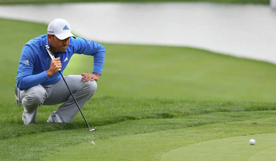 Sergio Garcia lines up his putt on No. 18, which he birdied, during the second round of the BMW Championship at Cherry Hills Country Club in Cherry Hills Village, Colorado. Photo: Brennan Linsley / Associated Press / AP