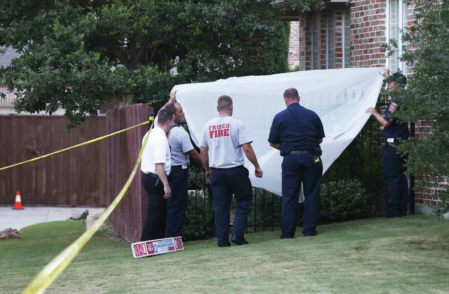 Frisco first responders cover a back gate at the home of Pallavi and Sumeet Dhawan on Wednesday, when Pallavi's body was found in the pool and her husband's was found inside the home. The husband had signs of blunt force trauma to the head and a broken hand, Assistant Police Chief Darren Stevens said. The wife had no signs of trauma, and there was no evidence of forced entry to the home, Stevens said. Photo: Vernon Bryant, Associated Press / Dallas Morning News
