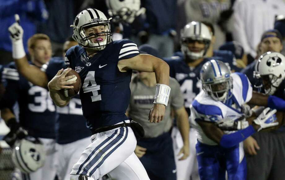 Last season, BYU QB Taysom Hill rushed for 259 yards in a rout of Texas. The Longhorns surrendered a school-record 550 rushing yards and 679 overall. Photo: Rick Bowmer / Associated Press / AP