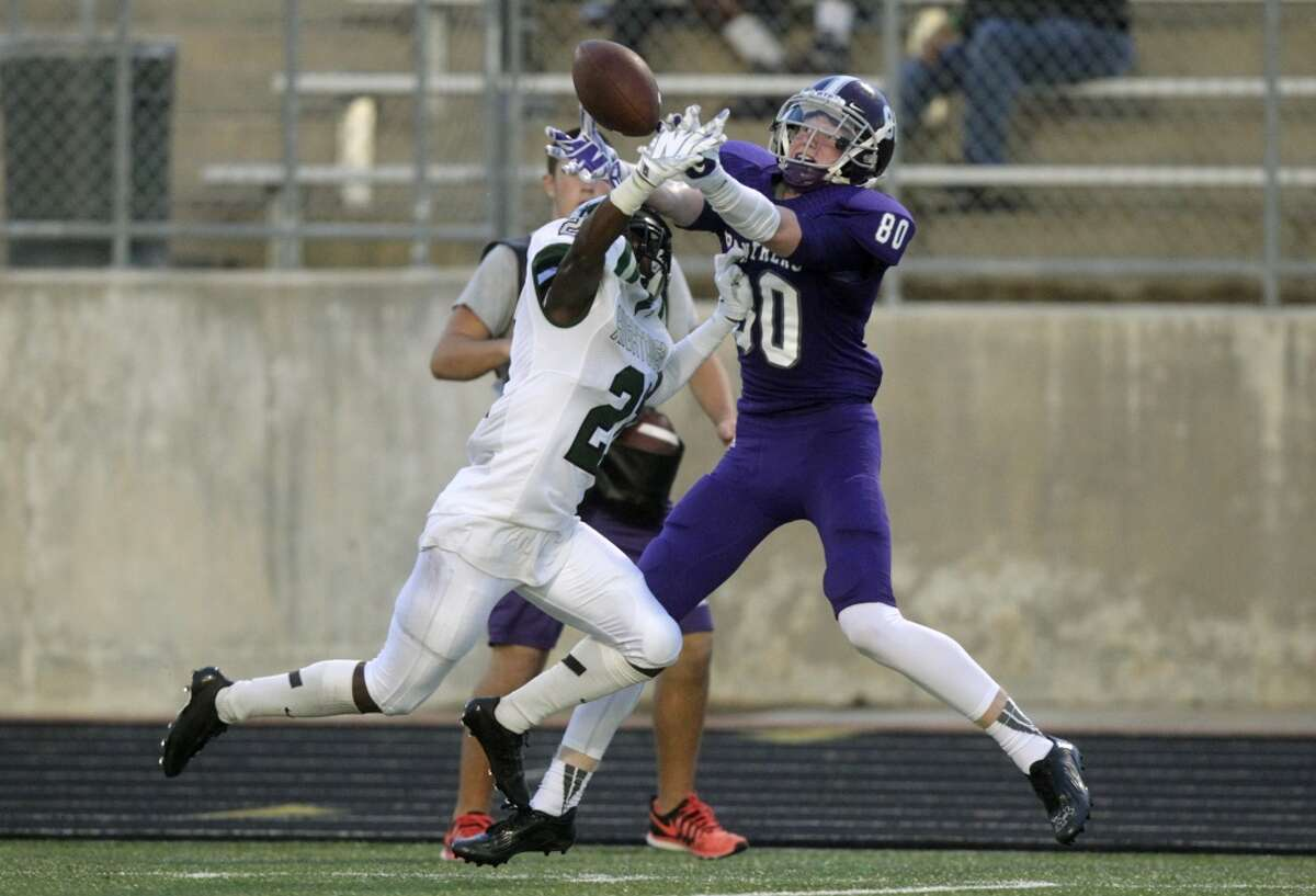 Hightower defensive back Robert Grays (21) is called for pass interference on Ridge Point Trey Brock (80) during the first half of a high school football game at Hall Stadium on Friday, Sept. 5, 2014, in Missouri City. ( J. Patric Schneider / For the Chronicle )