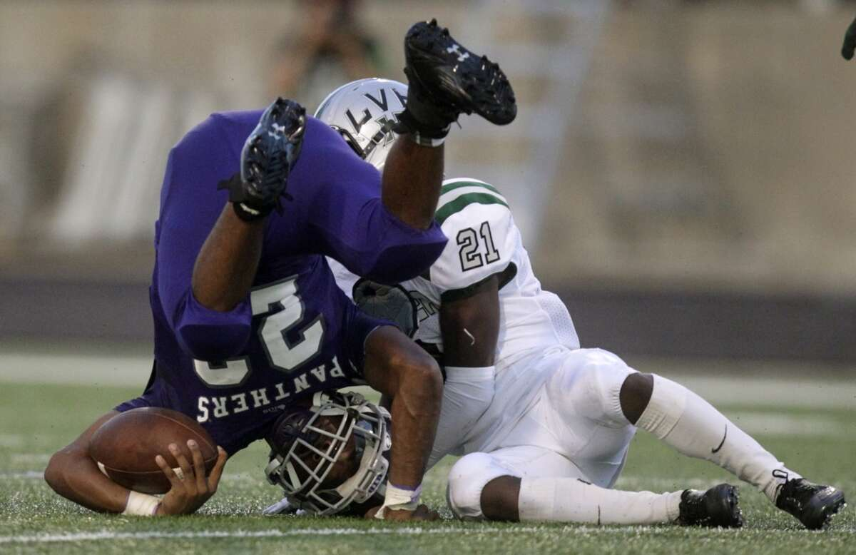 Ridge Point running back Remus Bulmer (22) is upended by Hightower defensive back Robert Grays (21) during the first half of a high school football game at Hall Stadium on Friday, Sept. 5, 2014, in Missouri City. ( J. Patric Schneider / For the Chronicle )