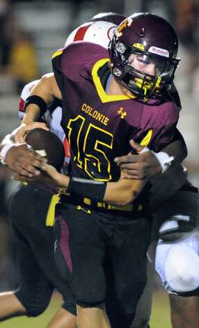 Colonie's quarterback Will McCann shakes off Guilderland defenders during their football game on Friday, Sept. 5, 2014, at Colonie High in Colonie, N.Y. (Cindy Schultz / Times Union) Photo: Cindy Schultz / 00028437A