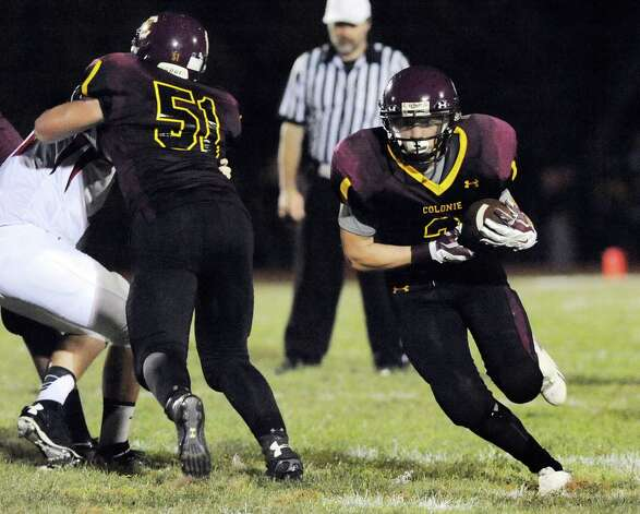 Colonie's Chris Flood, right, gets protection during their football game against Guilderland on Friday, Sept. 5, 2014, at Colonie High in Colonie, N.Y. (Cindy Schultz / Times Union) Photo: Cindy Schultz / 00028437A