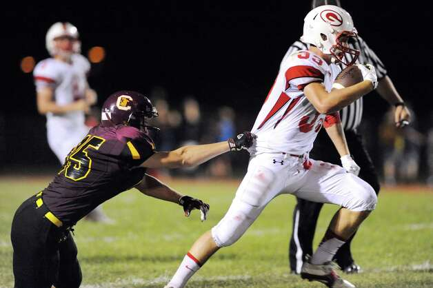 Guilderland's Cameron Long, right, gains yards as Colonie's Austin Crisafulli hangs on during their football game on Friday, Sept. 5, 2014, at Colonie High in Colonie, N.Y. (Cindy Schultz / Times Union) Photo: Cindy Schultz / 00028437A