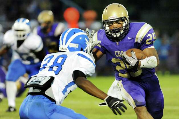 CBA's Nasir Tune, right, reaches out to stiff arm Shaker's Andrew Bolton during their football game on Friday, Sept. 5, 2014, at Christian Brothers Academy in Colonie, N.Y. (Cindy Schultz / Times Union) Photo: Cindy Schultz / 00028436A