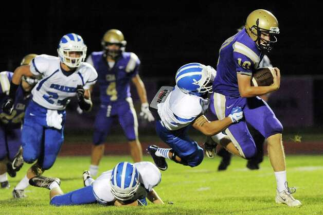 CBA's Donald Vivian, right, runs the ball during their football game against Shaker on Friday, Sept. 5, 2014, at Christian Brothers Academy in Colonie, N.Y. (Cindy Schultz / Times Union) Photo: Cindy Schultz / 00028436A