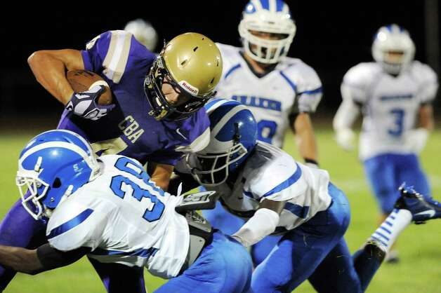 CBA's Ben Anthony, left, carries the ball as Shaker's Andrew Bolton gets help with the tackle during their football game on Friday, Sept. 5, 2014, at Christian Brothers Academy in Colonie, N.Y. (Cindy Schultz / Times Union) Photo: Cindy Schultz / 00028436A