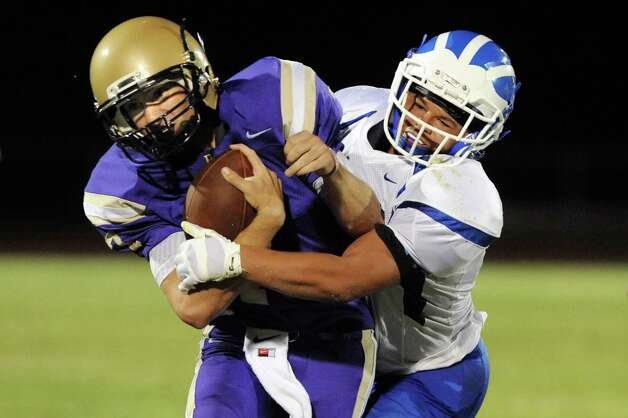 CBA's quarterback Joe Kolbe carries the ball as a Shaker defender does his work during their football game on Friday, Sept. 5, 2014, at Christian Brothers Academy in Colonie, N.Y. (Cindy Schultz / Times Union) Photo: Cindy Schultz / 00028436A