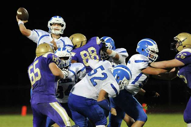 Shaker's quarterback Matt Woods, top left, throws over CBA defenders during their football game on Friday, Sept. 5, 2014, at Christian Brothers Academy in Colonie, N.Y. (Cindy Schultz / Times Union) Photo: Cindy Schultz / 00028436A