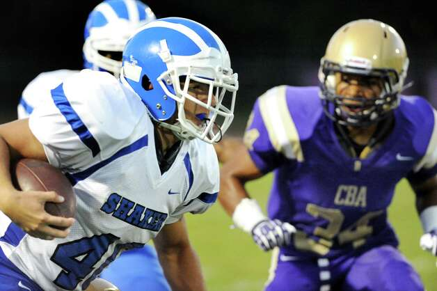 Shaker's Ryan Duda, left, carries the ball during their football game on Friday, Sept. 5, 2014, at Christian Brothers Academy in Colonie, N.Y. (Cindy Schultz / Times Union) Photo: Cindy Schultz / 00028436A