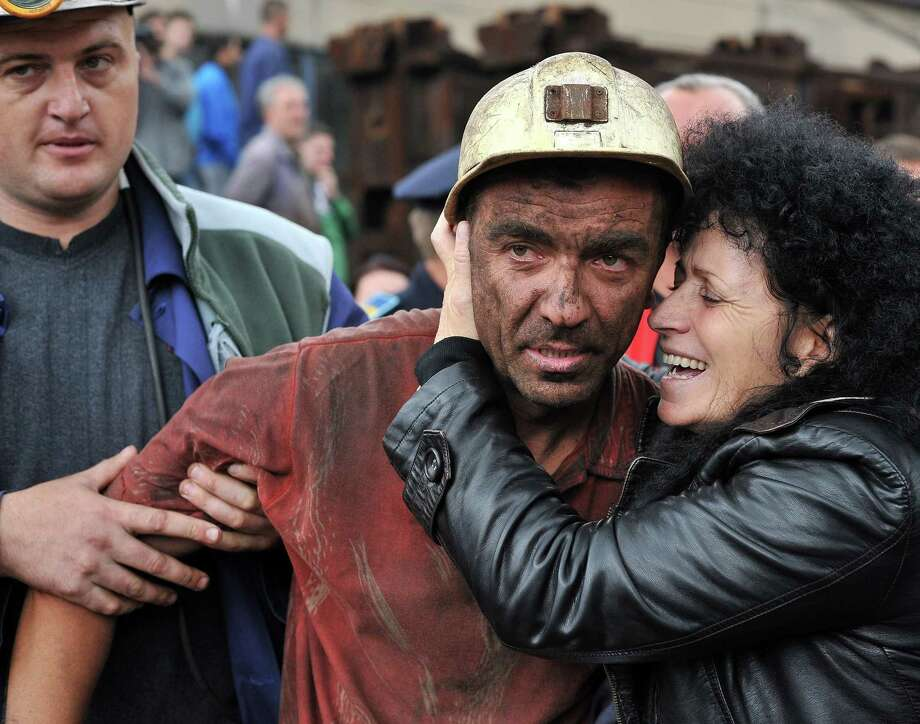 One of the coal miners is greeted as he exits the Raspotocje mine in Zenica, central Bosnia. Five miners are presumed dead after an earthquake triggered a gas explosion and tunnel cave-in. Photo: Elvis Barukcic / Getty Images / AFP