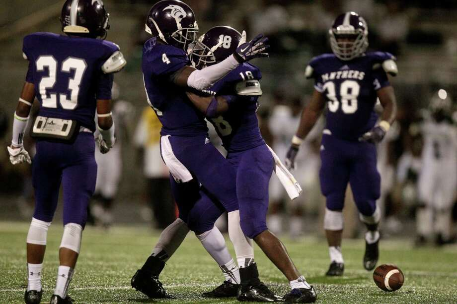 Ridge Point safety Tyler Turner (18) celebrates with teammate Jameel Cook after he intercepted the ball during the fourth quarter of a high school football game against Hightower at Hall Stadium on Friday, Sept. 5, 2014, in Missouri City. ( J. Patric Schneider / For the Chronicle ) Photo: J. Patric Schneider, Freelance / © 2014 Houston Chronicle