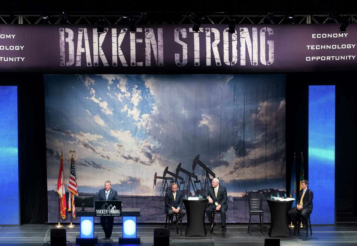 Tommy Nusz, left, CEO of Oasis Petroleum; Harold Hamm, second from left, chairman of Continental Resources; and Jim Volker, CEO of Whiting Petroleum, spoke last May at an oil expo in Bismarck, N.D.