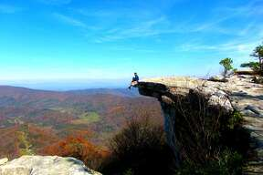 A hiker finds a picturesque resting spot on the Appalachian Trail near Roanoke, Virginia.