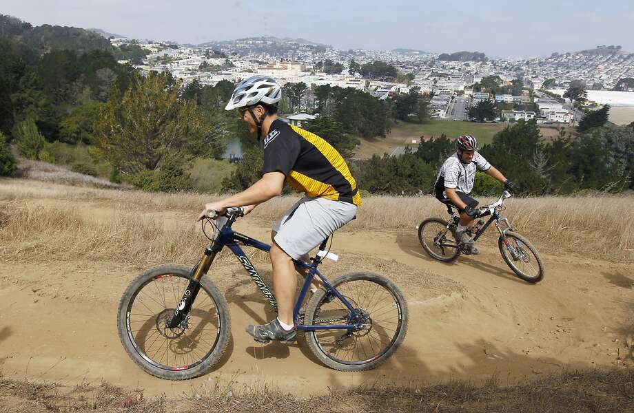 Competitors race on a series of switchbacks during the second annual SF Mountain Bike Festival at the 317-acre McLaren Park. Photo: Paul Chinn, The Chronicle