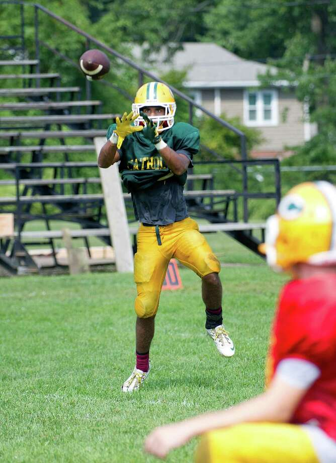 Randy Polonia practices with the Trinity Catholic football at the high school on Saturday, September 6, 2014. Photo: Lindsay Perry / Stamford Advocate