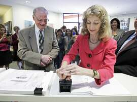 """FILE - In this Aug. 15, 2011 file photo, California Secretary of State Debra Bowen certifies one of the new legislative and congressional maps  as California Citizens Redistricting Commission member Vincent Barabba watches at the Capitol in Sacraamento. Bowen, beset by frequent absences, has moved from her house into a mobile home park. Two months before Californians go to the polls to choose a governor, the state's top elections official tearfully acknowledged Friday, Sept. 5, 2014, that she has been consumed by a """"debilitating"""" depression that has often kept her away from the office.(AP Photo/Rich Pedroncelli, File)"""