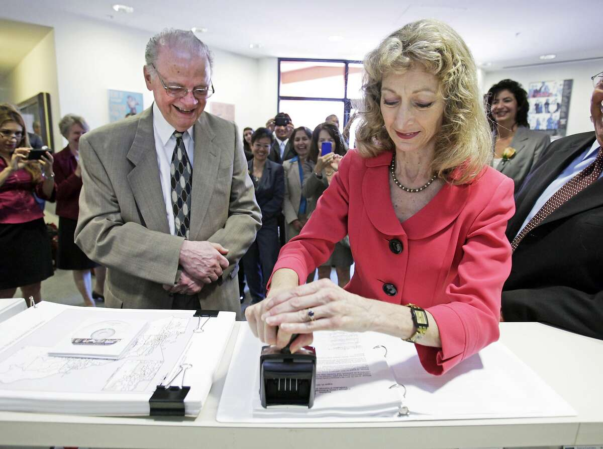 FILE - In this Aug. 15, 2011 file photo, California Secretary of State Debra Bowen certifies one of the new legislative and congressional maps as California Citizens Redistricting Commission member Vincent Barabba watches at the Capitol in Sacraamento. Bowen, beset by frequent absences, has moved from her house into a mobile home park. Two months before Californians go to the polls to choose a governor, the state's top elections official tearfully acknowledged Friday, Sept. 5, 2014, that she has been consumed by a