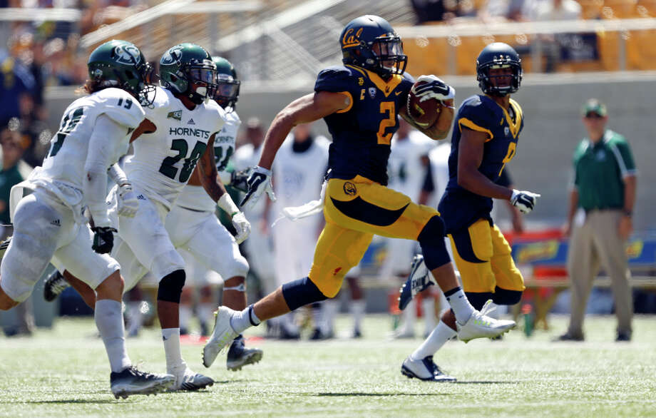 Daniel Lasco, dashing 50 yards for a score against Sacramento State, looks forward to a second chance at the Coliseum. Photo: Scott Strazzante / The Chronicle / ONLINE_YES