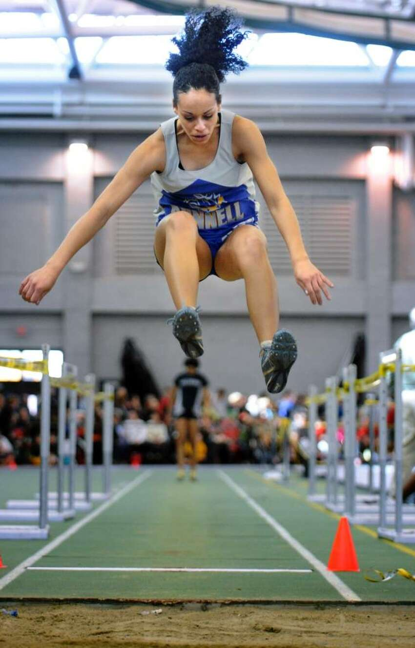 Bunnell's Alisha Beeman competes in the long jump event Saturday Feb. 20, 2010 at the CIAC State Championship Indoor Track and Field meet at the New Haven Athletic Center.