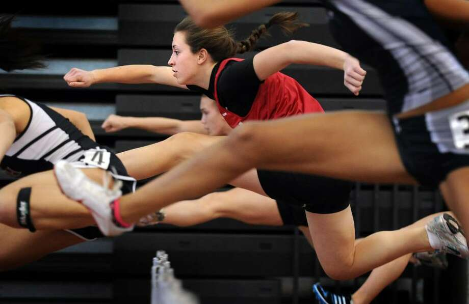Masuk's Amanda Snajder competes in the 55 Meter Hurdles Saturday Feb. 20, 2010 at the CIAC State Championship Indoor Track and Field meet at the New Haven Athletic Center. Photo: Autumn Driscoll / Connecticut Post