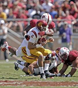 Stanford's Peter Kalambayi, (34) sacks USC quarterback Cody Kessler, (6) in the second quarter, as the Stanford Cardinal takes on the USC Trojans at Stanford Stadium in Palo Alto, Calif.,  on Saturday Sept. 6, 2014.