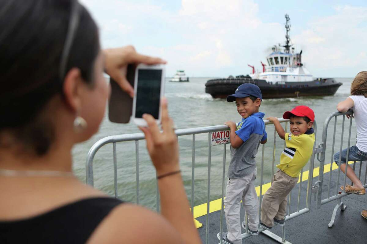Sam Lozano, 5, and Jason Lozano, 3, are photographed by their mother as a tugboat cruises by during the Centennial Family Festival at Bayport Cruise Terminal on Saturday, Sept. 6, 2014, in Pasadena.