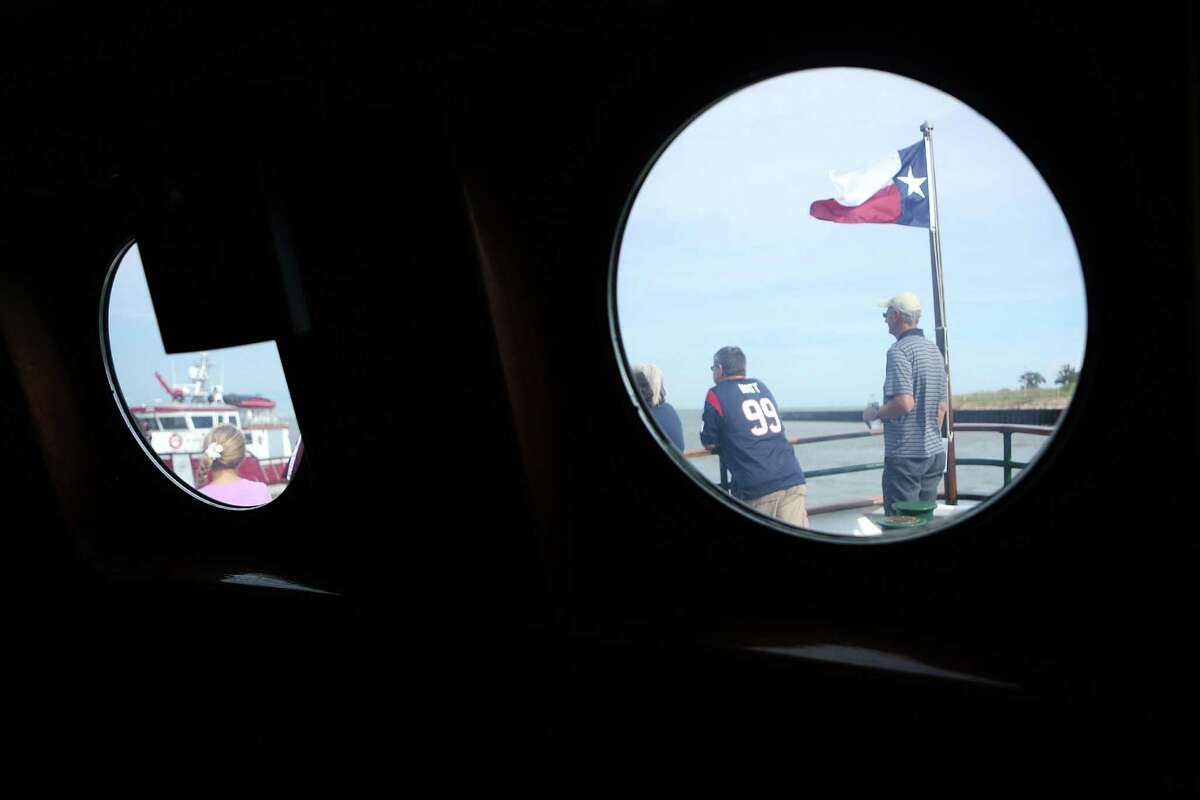 Visitor view the Port of Houston Fire boat during the Centennial Family Festival at Bayport Cruise Terminal on Saturday, Sept. 6, 2014, in Pasadena.