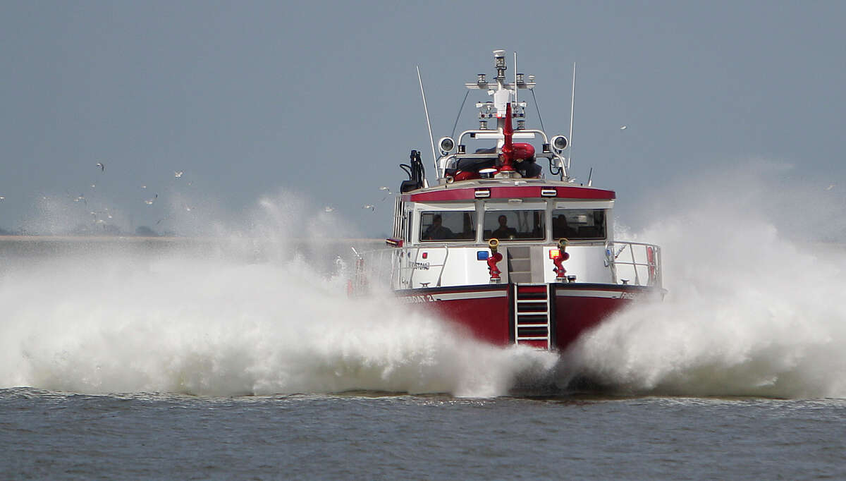 A Port of Houston Fire boat demonstrates speed to visitors during the Centennial Family Festival at Bayport Cruise Terminal on Saturday, Sept. 6, 2014, in Pasadena.