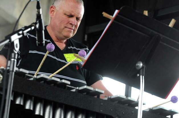 Vibraphonist Michael Benedict plays during the Albany Riverfront Jazz Festival at the Corning Preserve on Saturday Sept. 6, 2014 in Albany, N.Y. (Michael P. Farrell/Times Union) Photo: Michael P. Farrell / 00028494A