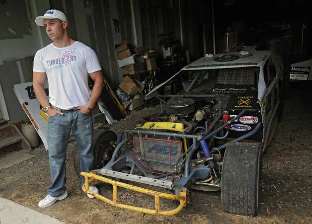 Emmanuel Donato, a recovering heroin addict and dealer, stands by his old racing car which is kept in a barn at his home on Tuesday, Aug. 12, 2014 in Altamont, N.Y.  (Lori Van Buren / Times Union) Photo: Lori Van Buren / 00028106A