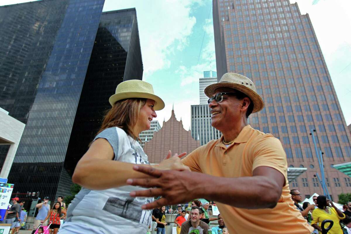 Gloria Costa and Manuel Vasquez, of Houston, dance to the music of Choro Ao Ponto at the Houston Brazilian Festival, sponsored by the Brazilian Arts Foundation, at Jones Plaza Saturday, Sept. 6, 2014, in Houston, Texas. The event featured live music, performances, food and more.