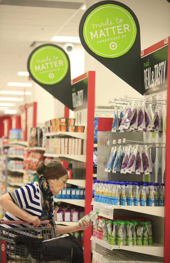 Rena Carlson of San Francisco looks over items in a Made to Matter focal display at  City Target on Thursday, September 4,  2014 in San Francisco, Calif. Photo: Lea Suzuki, The Chronicle