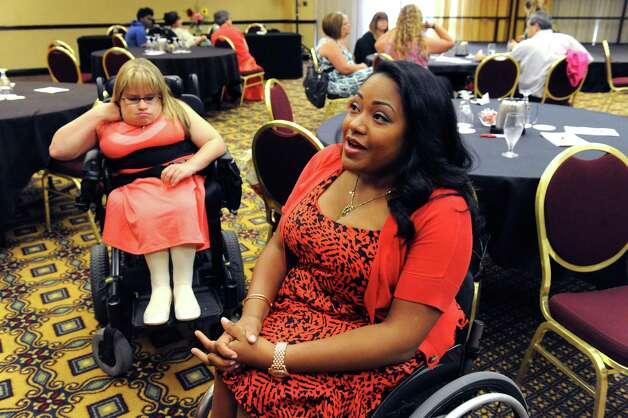Andrea Dalzell, center, of Brooklyn winner of this years Ms. Wheelchair New York Pageant on Saturday Sept. 6, 2014 in Colonie, N.Y. (Michael P. Farrell/Times Union) Photo: Michael P. Farrell / 00028390A