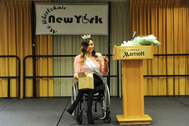 Jessica Patterson of Weedsport, N.Y Ms. Wheelchair New York 2013 gets ready to crown this years winner during the pageant on Saturday Sept. 6, 2014 in Colonie, N.Y. (Michael P. Farrell/Times Union) Photo: Michael P. Farrell / 00028390A
