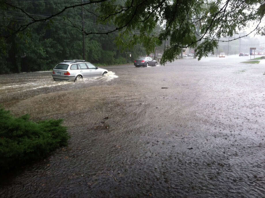 Water several inches deep floods Post Road East in the wake of strong storms Saturday evening. Photo: Jarret Liotta / Westport News