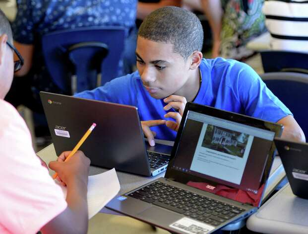 Members of the inaugural class of the Troy Riverfront  P-tech program work on their projects Thursday afternoon  Sept. 4, 2014, at Troy High School in Troy, N.Y.   (Skip Dickstein/Times Union) Photo: SKIP DICKSTEIN / 00028477A