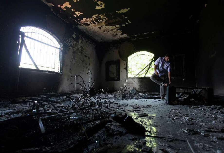 The inside of the U.S. consulate in Benghazi shows the devastation two days after the attack that claimed the life of the U.S. ambassador and three other Americans in September 2012. Photo: Associated Press File Photo / AP