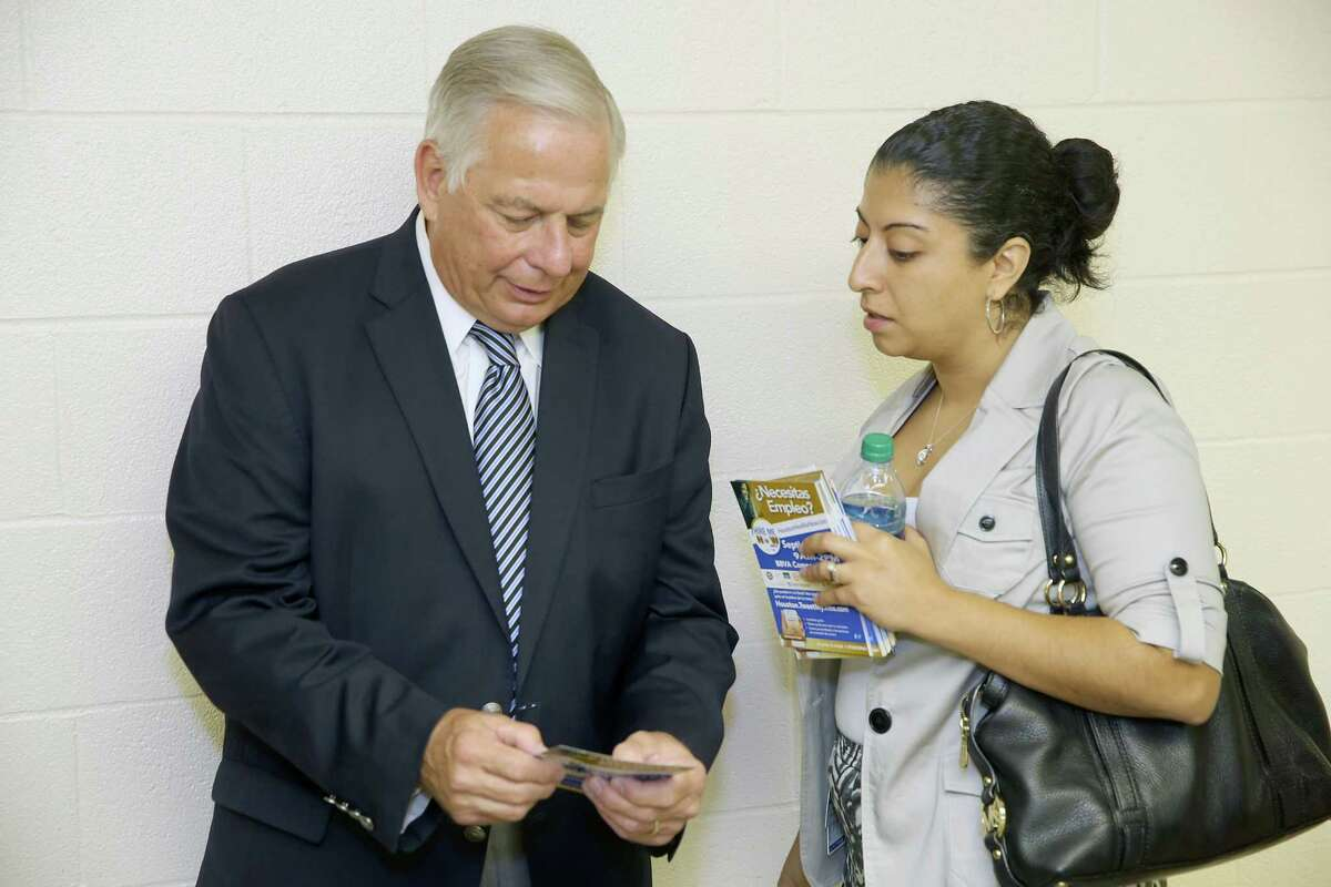"""U.S. Rep. Gene Green speaks with Tanya Makany-Rivera, external affairs manager for the city of Houston, at a recent Town Hall meeting in Houston. As for not being Hispanic, Green says, """"I don't think I'd get re-elected or elected if I wasn't doing the job."""""""
