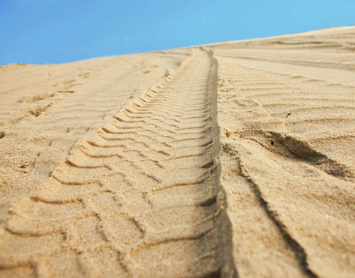 Tire tracks on sand.