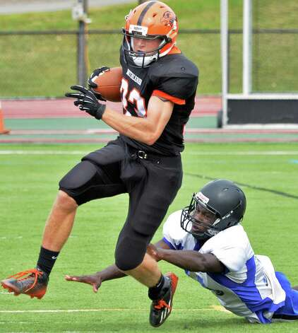 Bethlehem's #33 Ben Tietjen, left, gets away from Albany High's #10 Tysheem Morris to score during Saturday's game at Union College's Frank Bailey Field  Sept. 6, 2014, in Schenectady,NY.  (John Carl D'Annibale / Times Union) Photo: John Carl D'Annibale / 00028439A