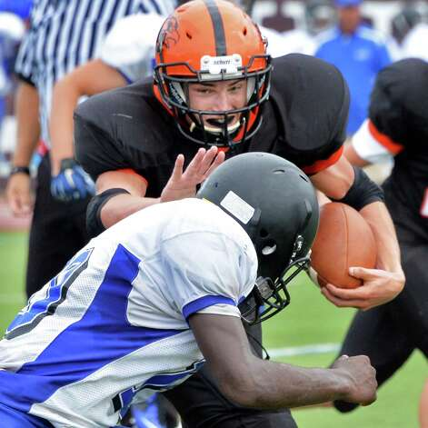 Bethlehem's #20 Ben Zonca, top,  plows through Albany High's defense during Saturday's game at Union College's Frank Bailey Field Sept. 6, 2014, in Schenectady,NY.  (John Carl D'Annibale / Times Union) Photo: John Carl D'Annibale / 00028439A