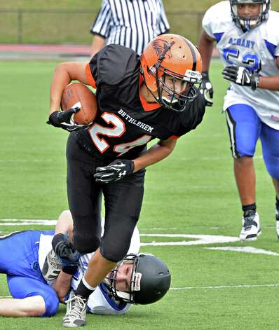 Bethlehem's #24 Mitch Calabrese tries to pull away from an Albany defender during Saturday's game Sept. 6, 2014, at Union College's Frank Bailey Field in Schenectady,NY.  (John Carl D'Annibale / Times Union) Photo: John Carl D'Annibale / 00028439A