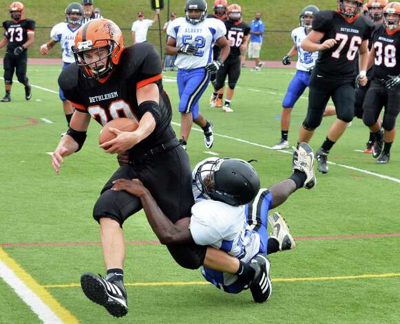 Bethlehem's #20 Ben Zonca gains makes it into the end zone to score during Saturday's game against Albany High Sept. 6, 2014, at Union College's Frank Bailey Field in Schenectady,NY.  (John Carl D'Annibale / Times Union) Photo: John Carl D'Annibale / 00028439A