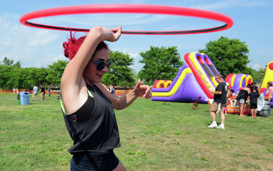 "Mallory Mucci, of Shelton, plays with a hula hoop during the Doc Dowling Chili Cookoff which is part of the Down by the River ""Bike For Hope"" and Music Festival held at Veterans Park in Shelton, Conn. on Saturday September 6, 2014. Photo: Christian Abraham / Connecticut Post"