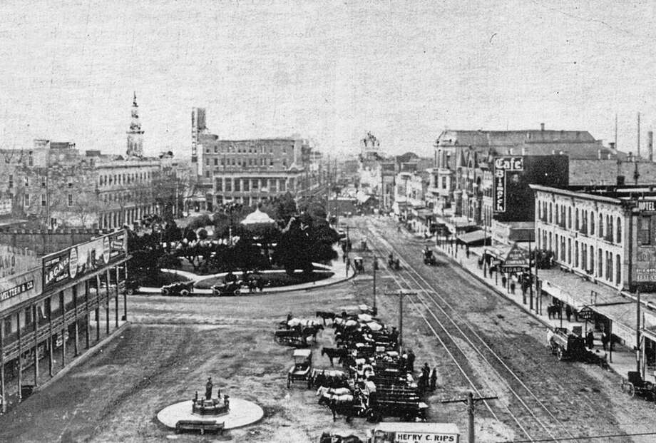 "Among the items that will be tweaked in the next edition of ""San Antonio Then and Now"" is the entry on Alamo Plaza, seen in 1898. Since the book's 2005 publication, custodianship of the Alamo has gone to the General Land Office. Photo: Courtesy Arcadia Publishing"