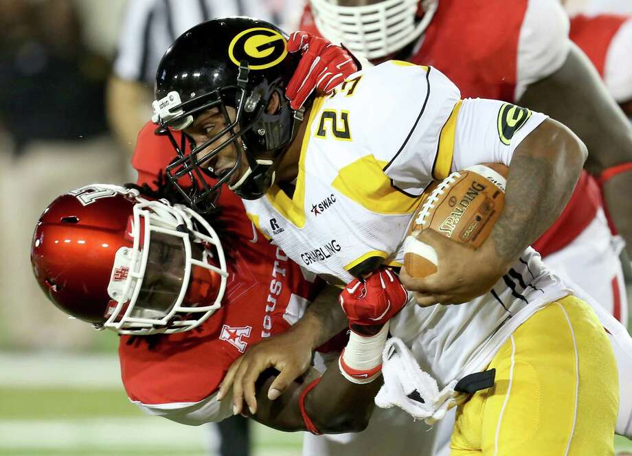 UH linebacker Steven Taylor brings down Grambling State running back Cedric Skinner as the Cougars' defense pitched a shutout Saturday night. Photo: Thomas B. Shea, Freelance / © 2014 Thomas B. Shea