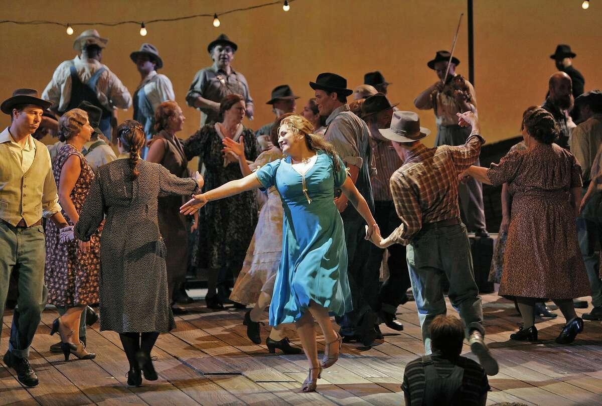 Patricia Racette (Susannah Polk) and San Francisco Opera Chorus.